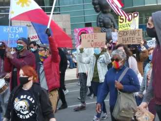 Demonstration against anti-Asian violence marching through downtown