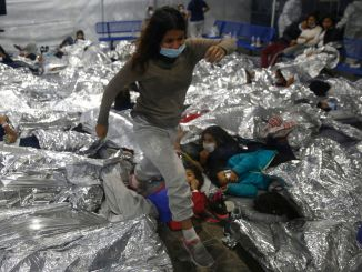 Migrant children sleeping in crowded conditions on the US southern border detention center
