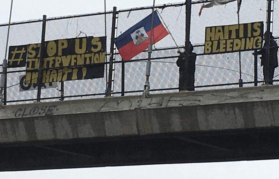 Freeway banner drop on July 28th, 2021 in Oakland, California over highway