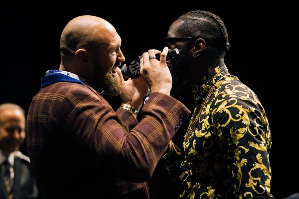 Fury and Wilder crank up hype as Joshua bides his time