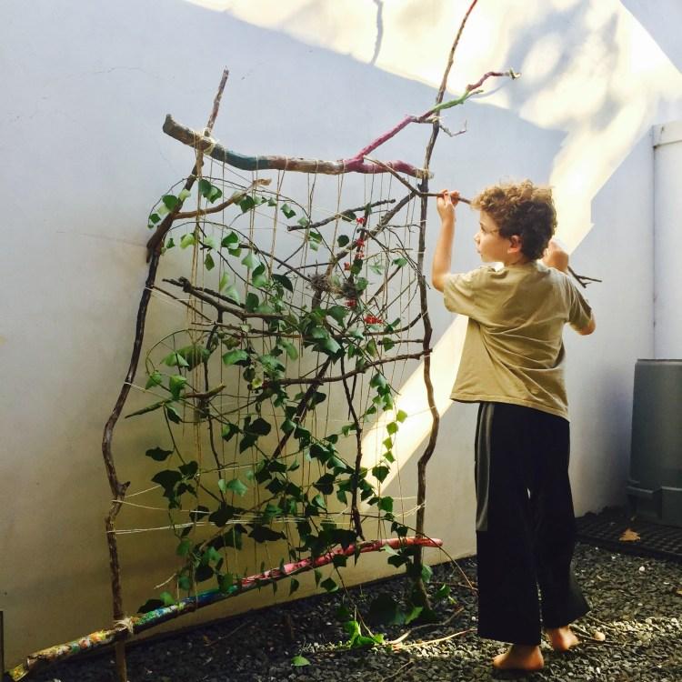 earth loom, weaving with kids, nature weaving, garden loom, nature art, branch weaving, Wee Warhols, Figment Creative, Austin, art class,