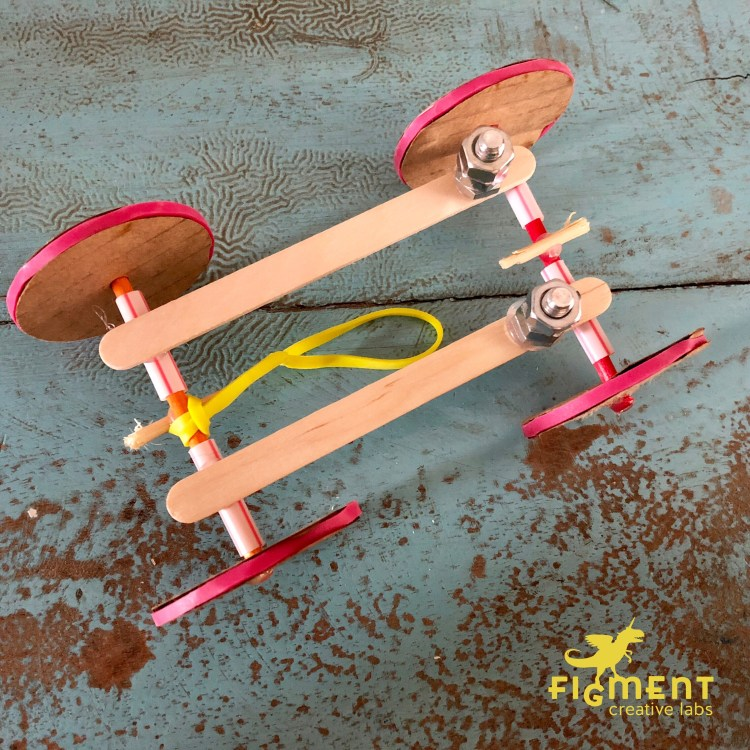 rubber band car, stem, steam. Figment Creative Labs, Austin Texas, engineering, kids activities, Newton's law of motion, elasticity, motion, DIY, mechanics,