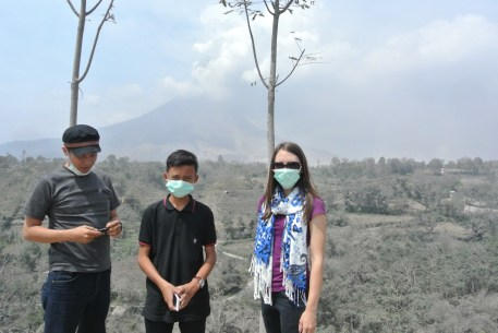 My friends and I wear masks and look at the ashy landscape from a safe distance.