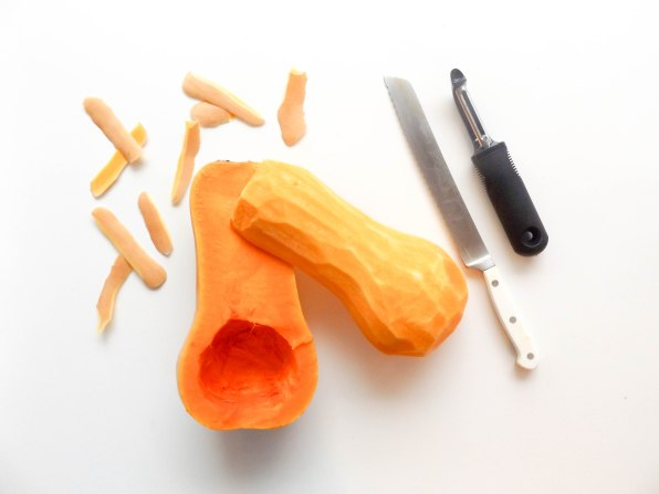 use a vegetable peeler to peel off the skin. the skin is very thick so you may need a knife to cut off some parts