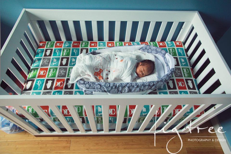 Little newborn in a crib
