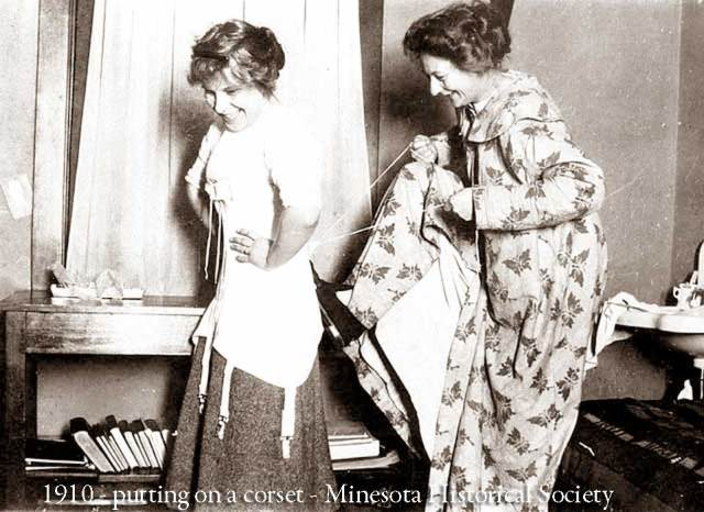 1910-putting-on-a-corset-Minesota-historical-Society