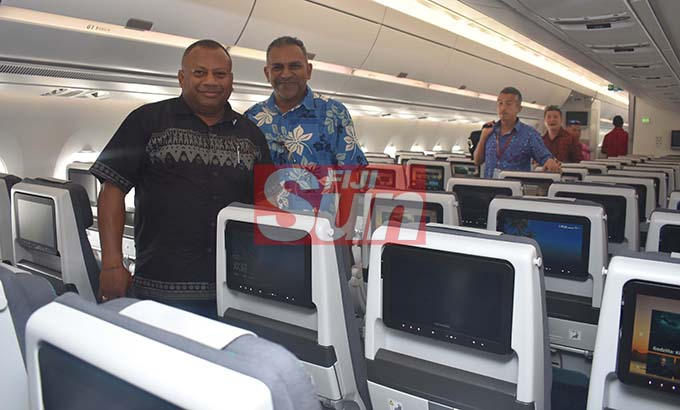 Minister For Agriculture Inia Seruiratu with former Minister Faiyaz Koya at the Fiji Airways A350 during the arrival ceremony at the Nadi International Airport yesterday. Photo: WAISEA NASOKIA