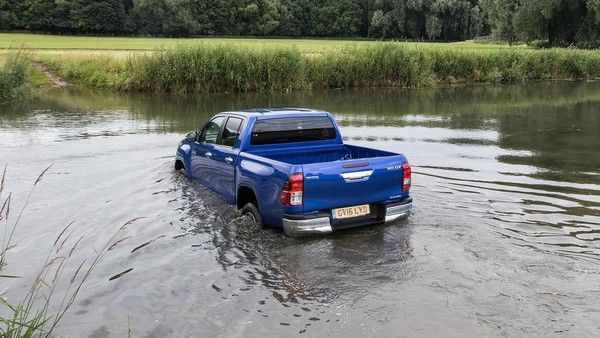 Toyota Hilux 2015 crossing over the river