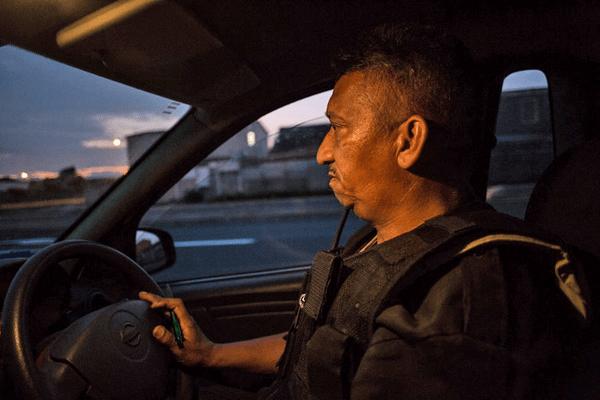 A policeman driving a car