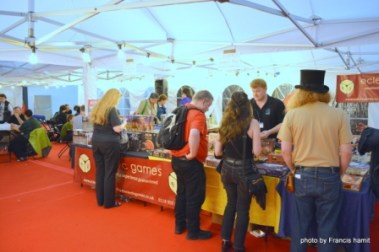 The Eclectic Games sales table in the Gaming Tent at Loncon 3's Fan Village.