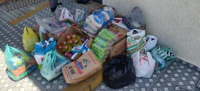 Em casa, membros colocaram alimentos no porta-malas do carro e na igreja, equipe fez retirada (Foto: Arquivo Pessoal).