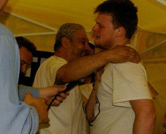 Barking Joe hugs Silent John
