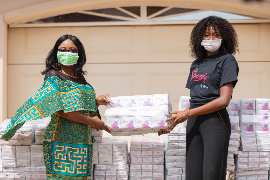 The Minister for Gender, Children and Social Protection, Mrs Cynthia Morrison (left) receiving the pads from Ms Ruth Quarshie, a representative of Sincerely Gh. Ltd.