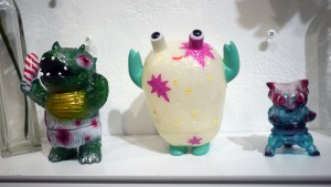 Bleeding Edges' Festive Caveman Dinosaur, Chima Group's Happy Surprise Bro, and Stacia Murphy's Song of Ice & Fire Mecha Nekoron from Gift Wrapped 2016 at The Clutter Gallery