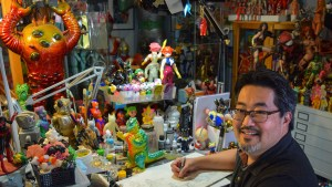 Mark Nagata in his studio with some of his collection