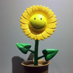 Ron English's Growing Grins - Smiley Sun Flower Sculpture