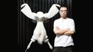 The artist Chao Woo with one of his creations