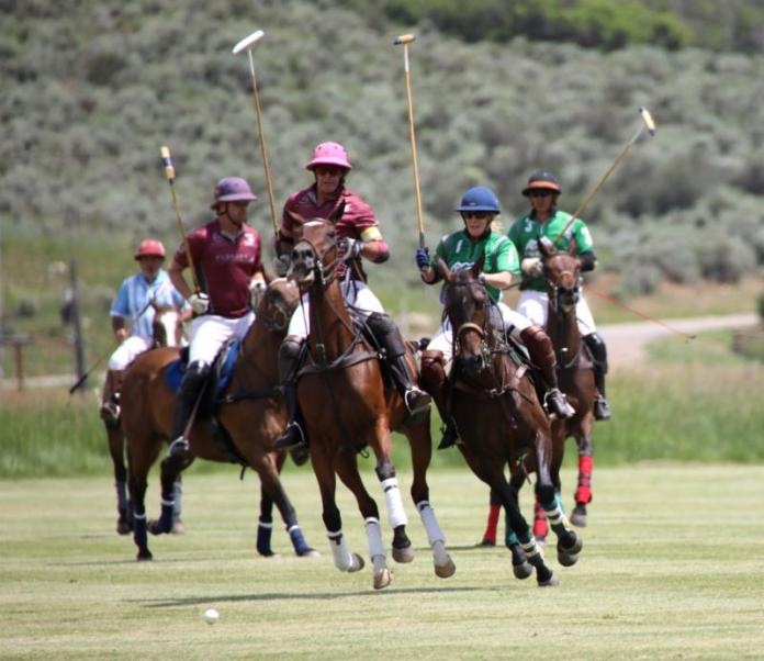 Juan Bollini of Flexjet follows up his hit with Lauren Sherry of Sopris Mountain Ranch defending.