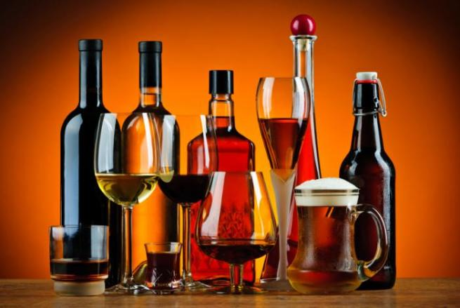 4 alcohol bottles and glasses