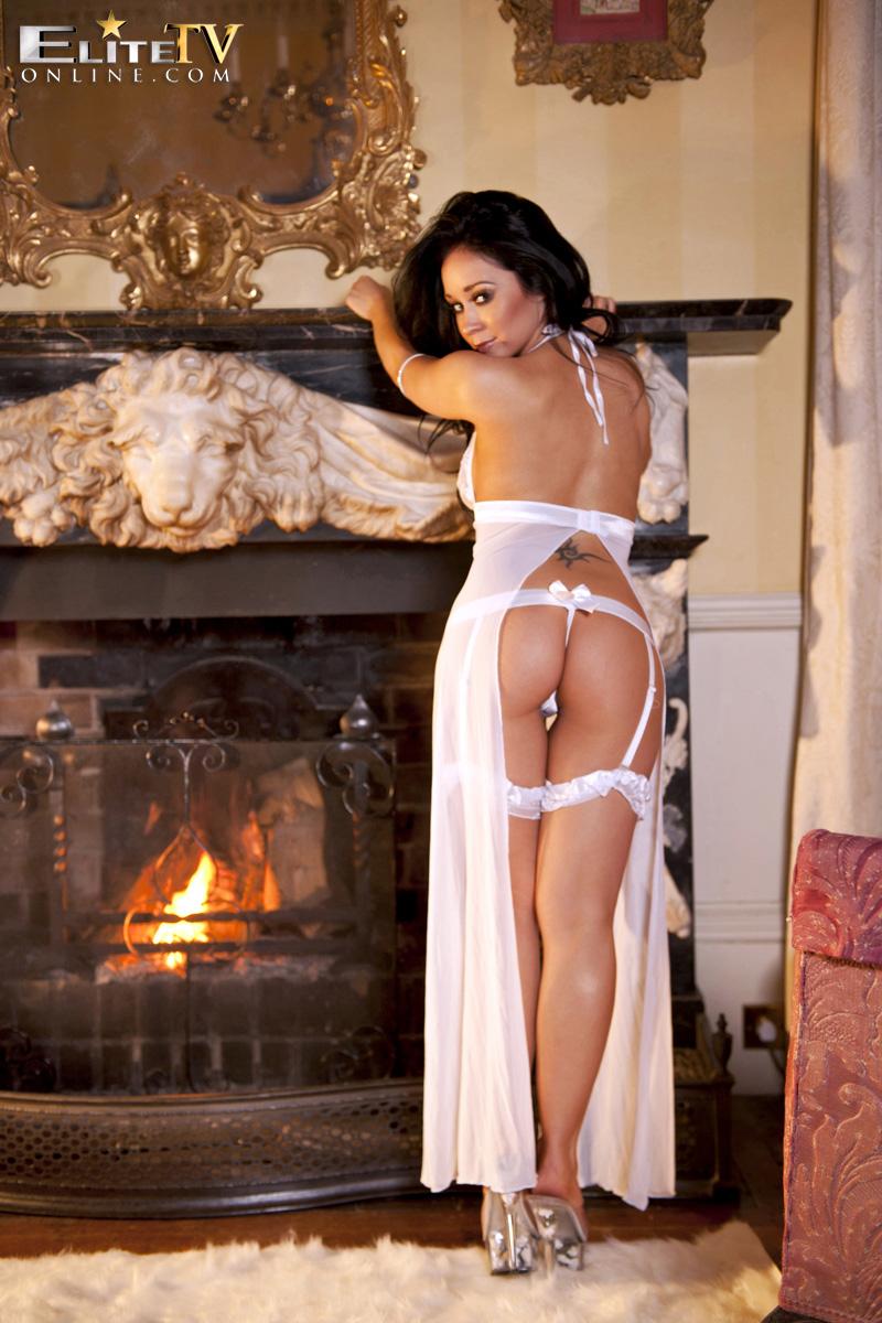 Caty Cole, brunette, strip, nude, busty, ass, fireplace