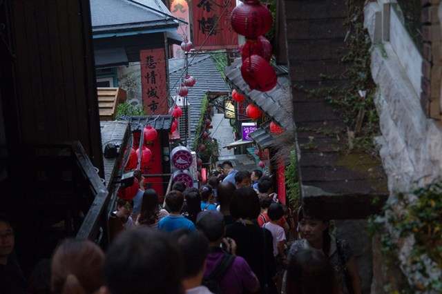 crowd of people on stairs in jiufen