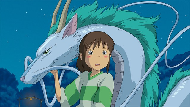 still from spirited away girl and dragon