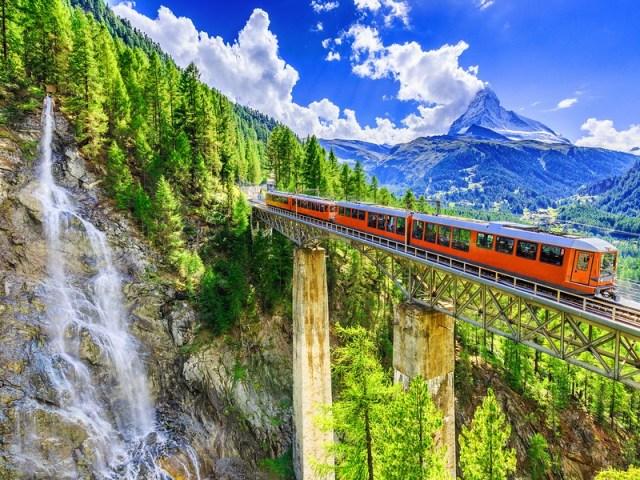 Zermatt Switzerland -  Gornergrat tourist train with waterfall bridge and Matterhorn