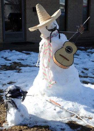"""Anicha Montoya built a Mariachi snow man in her yard Monday with help from her neighbors, Aaliyah Ramirez, 10, Isayah Ramirez 11, Josiyah Ramirez, 9, and their uncle Adrian Lopez. """"I decided to play with them in the snow because when do we ever get snow like that?"""" Montoya said."""