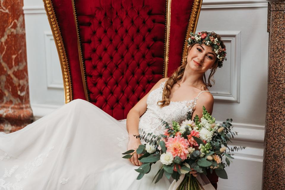 fillongley hall - exclusive warwickshire wedding venue - bride sitting on chair in the grand entrance hall way - country house