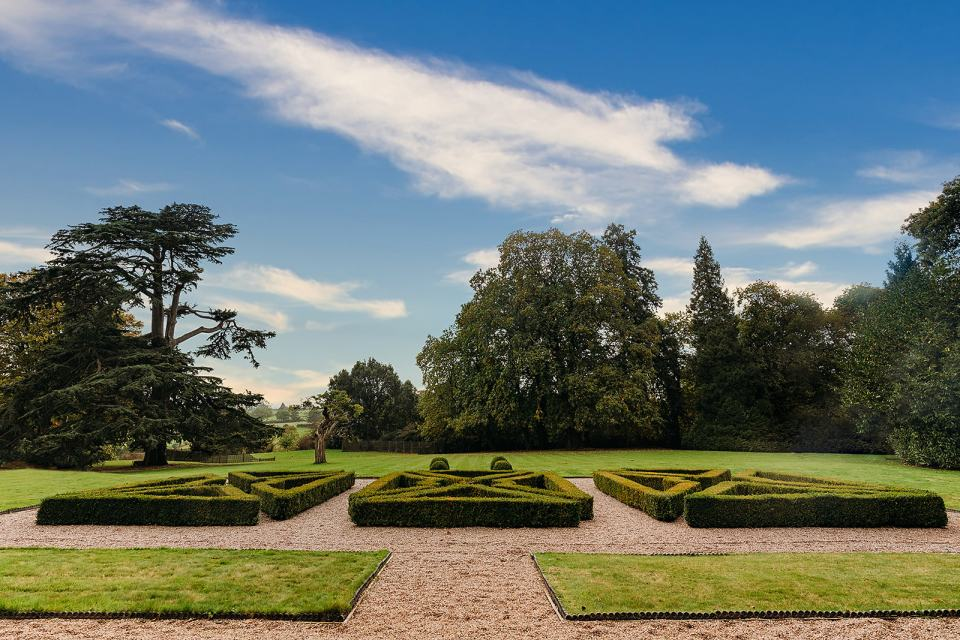 fillongley hall - warwickshire wedding venue - photo of the formal gardens looking out onto countryside