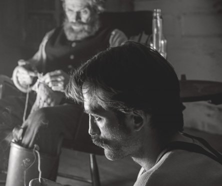 lighthouse-the-2019-003-robert-pattinson-foreground-willem-dafoe-seated-background