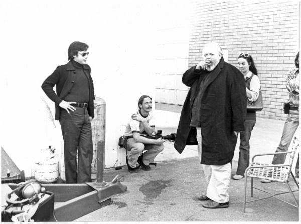 "From left: Peter Bogdanovich, Bill Weaver, (seated), Orson Welles and Oja Kodar on location during the filming of Orson Welles' last unfinished film ""The Other Side of the Wind."" Photo by José María Castellví"