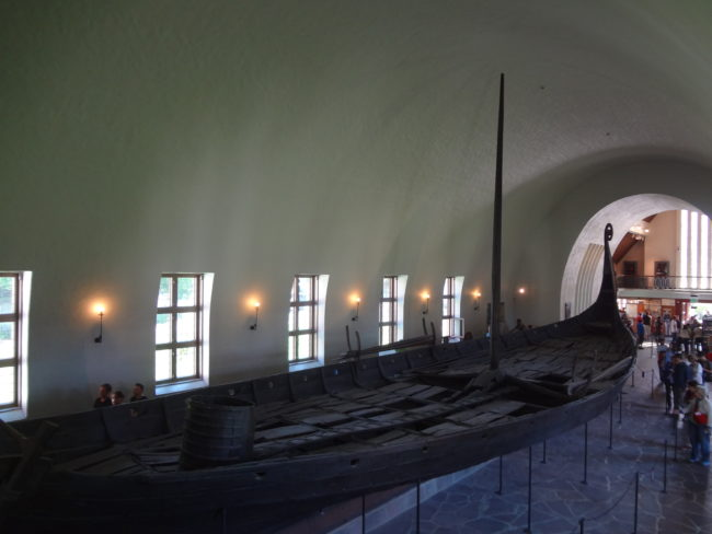 The Oseberg ship seen from the viewing platform. © Sonja Irani / FilmFanTravel.com