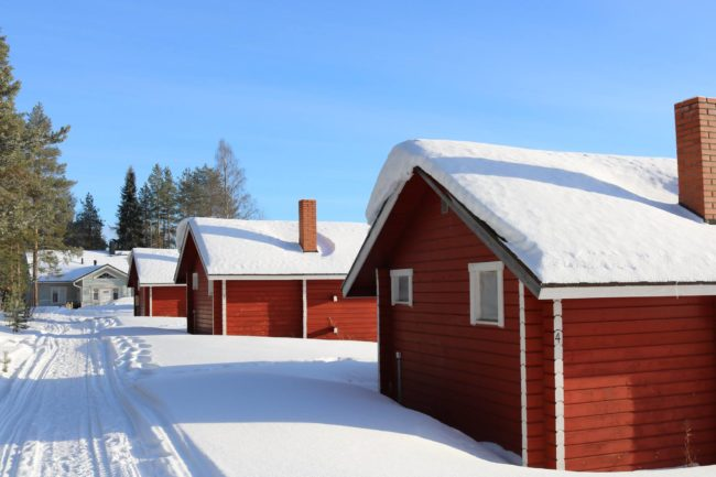 Snow-covered houses in Finish Lapland. Photo: © Sonja Irani / FilmFanTravel.com