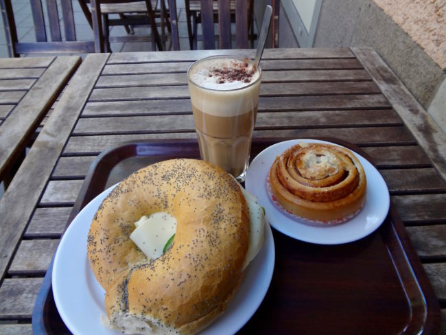Coffee, cinnamon bun and over-sized poppy seed bagel. © Sonja Irani / FilmFanTravel.com