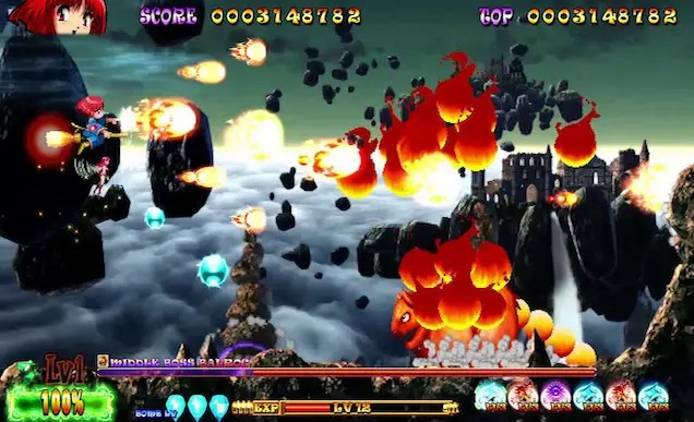 A screenshot from a video game. It is a 2D side-scrolling shoot em up. On the far left is a red-haired witch flying on a broom, shooting fireballs from her wand. To the right is an enemy made out of dark red balls of fire. In the background are clouds and a castle on a mountaintop.