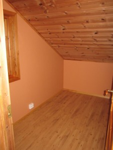 The bedroom upstairs outside the home theater.