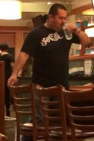 "Ramos guzzles a drink before leaving the establishment. ""Killer cops aren't welcome here,"" read the caption."