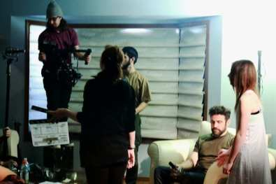 A still from the set of the short film Apparitions. Film crew prepping for a shot.