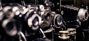 A picture of many vintage cameras. On our contact us page.