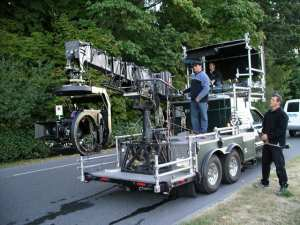 A technocrane on the back of a truck.