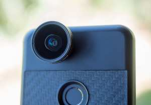 A phone with a lens adapter on it for certain filmmaking apps.