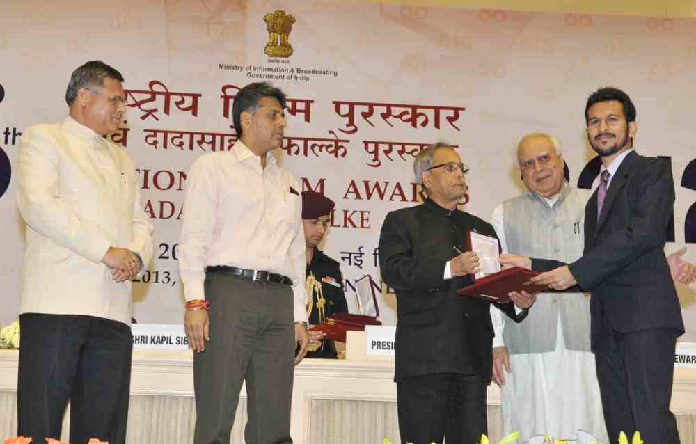 A snap Of receiving National Award From the President of India, for the Film 'After Glow'