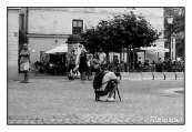 A DSLR-wielding tourist entertains a local. Canon P, Jupiter-8, Kodak Tri-X