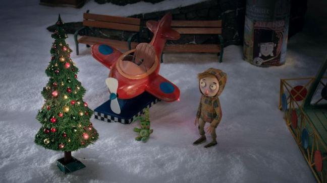 Vánoční balada je další z příběhů Břetislava Pojara. Hudbu složil Jan. P. Muchow. Na obrázku je malých chlapec a letadlo v zimní krajině u vánočního stromku