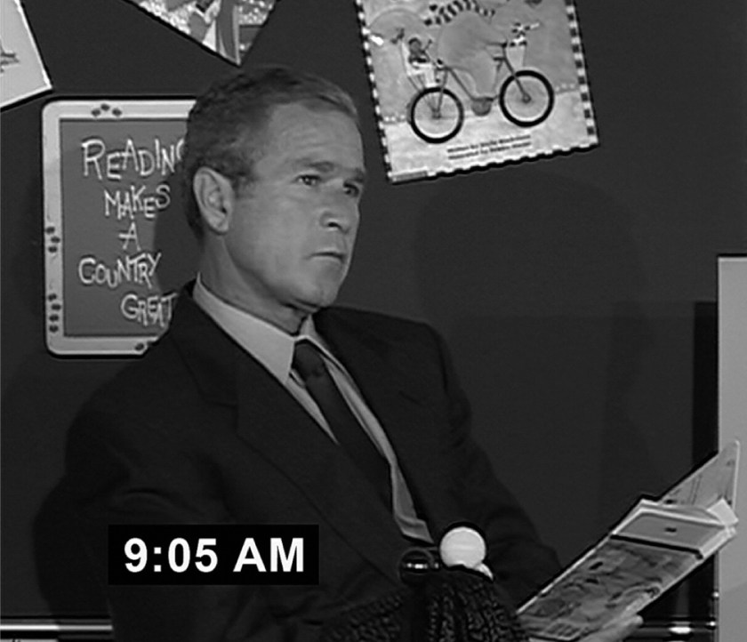 "George W. Bush reads ""My Pet Goat."" © Photofest)"