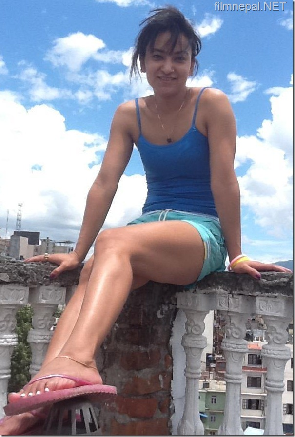 jharana_thapa_sitting_on_railings