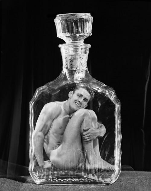 Bob Mizer, Leonard Chambers (in flask), Los Angeles, 1950