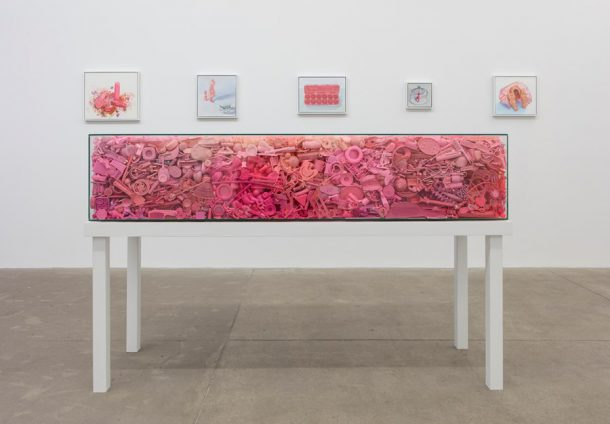"""Portia Munson, """"Her Coffin"""", 2016, found pink plastic, tempered glass and recycled wood table (Courtesy the artist and PPOW Gallery)"""
