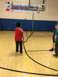 The battle ropes get some action as a student does alternating arm swings on the ropes. (Photo/Jaryd Leady)